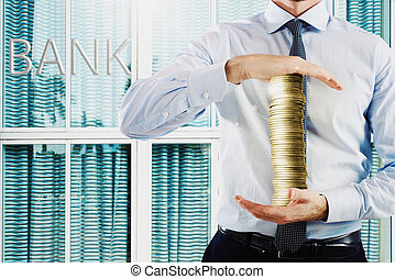 Earn and preserve - Businessman holds in his hands a stack...