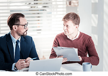 Earnest male colleagues changing business plan
