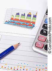 Earnings - Calculator and pencil on earnings chart...