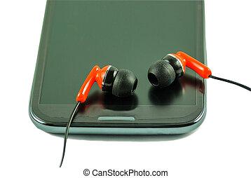 Earphone  and smartphone - Orange earphone and smartphone.