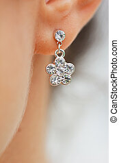 Earring in his ear close up