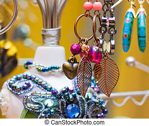 Earrings - An image of a sparkling assortment of earrings on...