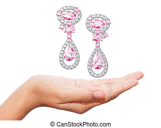 Earrings close-up in the hands . jewelry accessories