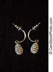 earrings on black background