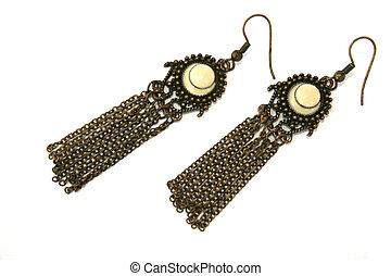 Wonderful metallic earrings isolated on the white.