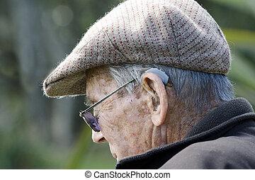 Ears hearing aid - Elderly man with hearing aid.