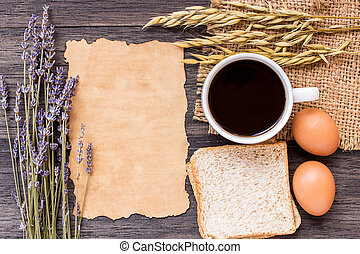 Ears of wheat, egg and coffee with slice of bread