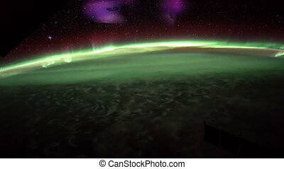 Earth and Aurora Borealis from ISS. Elements of this video furnished by NASA.