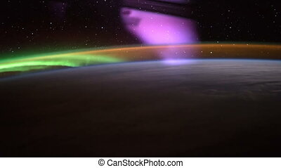 Earth and Aurora Borealis seen from ISS. Elements of this...