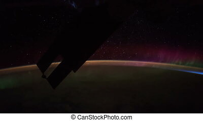 Earth and Aurora Borealis seen from ISS. Elements of this video furnished by NASA.