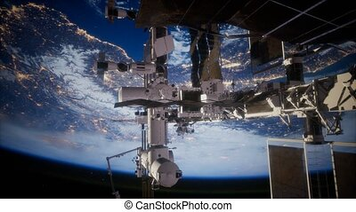 Earth and outer space station iss. Elements of this image...