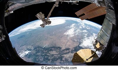 Earth as seen through window of International Space Station...