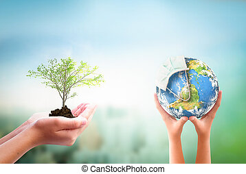 Earth Day concept: hands holding Corona virus or COVID-19 ...