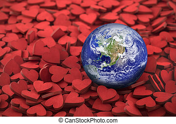Earth Day concept. World globe on hundreds of small red hearts. Earth photo provided by Nasa.