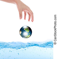 Earth drop from hand over water (Elements of this image...
