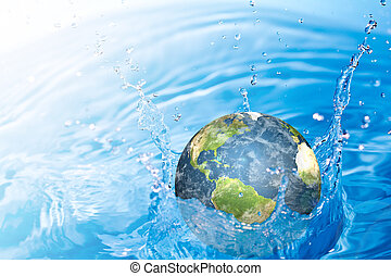 Earth falling into water (Elements of this image furnished...