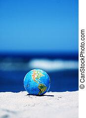 Earth globe. Conceptual image - Earth globe on the beach....