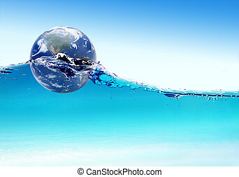 Earth globe floats on water ripples. Elements of this image furnished by NASA