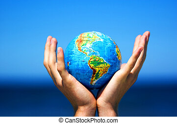 Earth globe in hands. Conceptual image - Earth globe in...