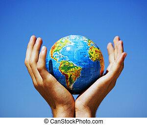 Earth globe in hands. Conceptual image - Earth globe in...