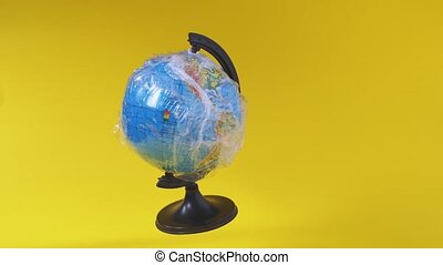 Earth globe in plastic. Ecology problem, pollution with plastic. School class of geography. Earth day. High quality 4k footage