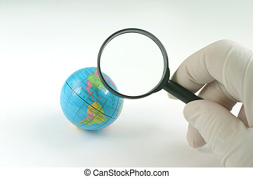 Earth globe & magnifying glass