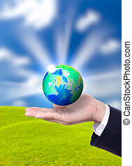 earth globe on hand