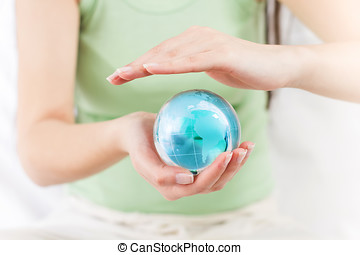 Earth Globe Protected - Green Earth Globe Protected by human...