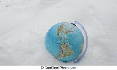 earth globe snow hat hand - earth globe sphere in snow...