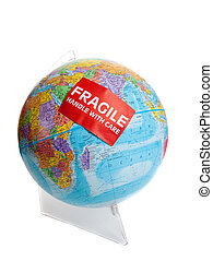 Earth globe with a fragile sticker