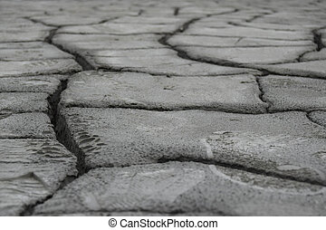 Earth ground crack with rough dry surface texture. Climate change and drought impact.