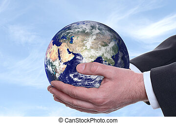 earth in a hands, blue 2