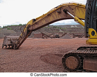 earth mover in a Porphyry rock quarry. mining industry