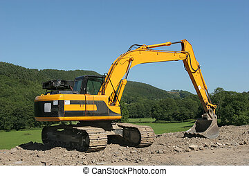 Earth Mover - Yellow track machine standing idle on a...
