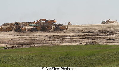 Earth moving construction - Earthmovers preparing new...