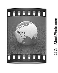 Earth on green grass. The film strip
