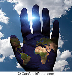 Earth on Hand with sky background
