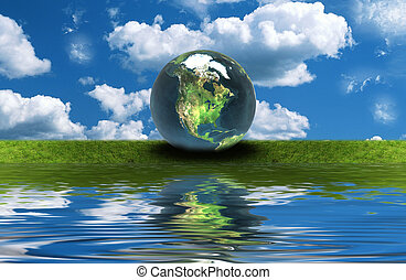 earth on the green grass with reflection