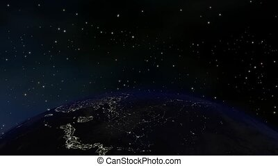 Earth orbiting through space, viewed from above at night