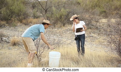 Earth Science Digging Location Inst - Female earth scientist...