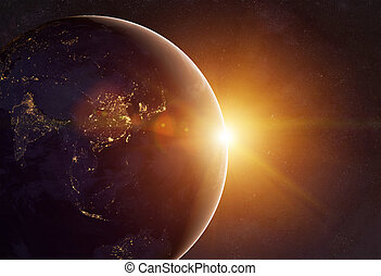 Earth - Our earth in cosmos and bright sun. Elements of this...