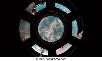 Earth through the porthole of ISS