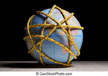 Earth tied up - Earth globe wrapped with rope