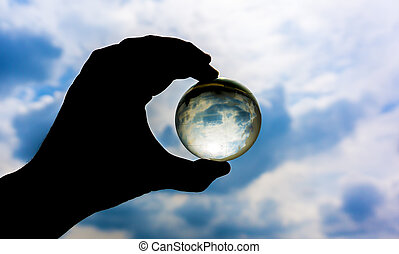 Earth transparent glass with hand silhouette