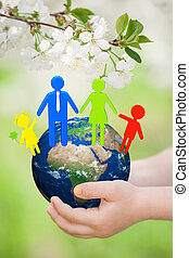 Earth with family in children`s hands