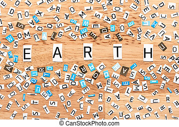 Earth word from cut out letters