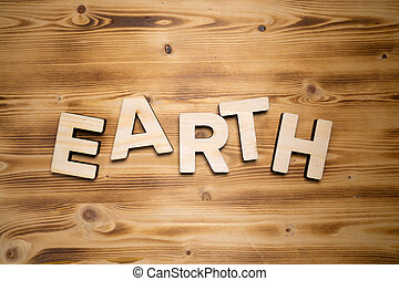 EARTH word made with building blocks on wooden board