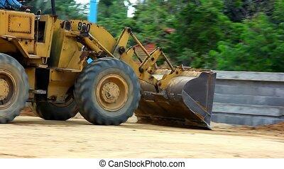 Earthmover dozer doing earthmoving works outdoors. -...