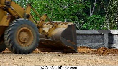 Earthmover dozer doing earthmoving works outdoors.