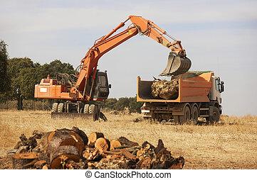 Earthmoving wheel loader machine and truck
